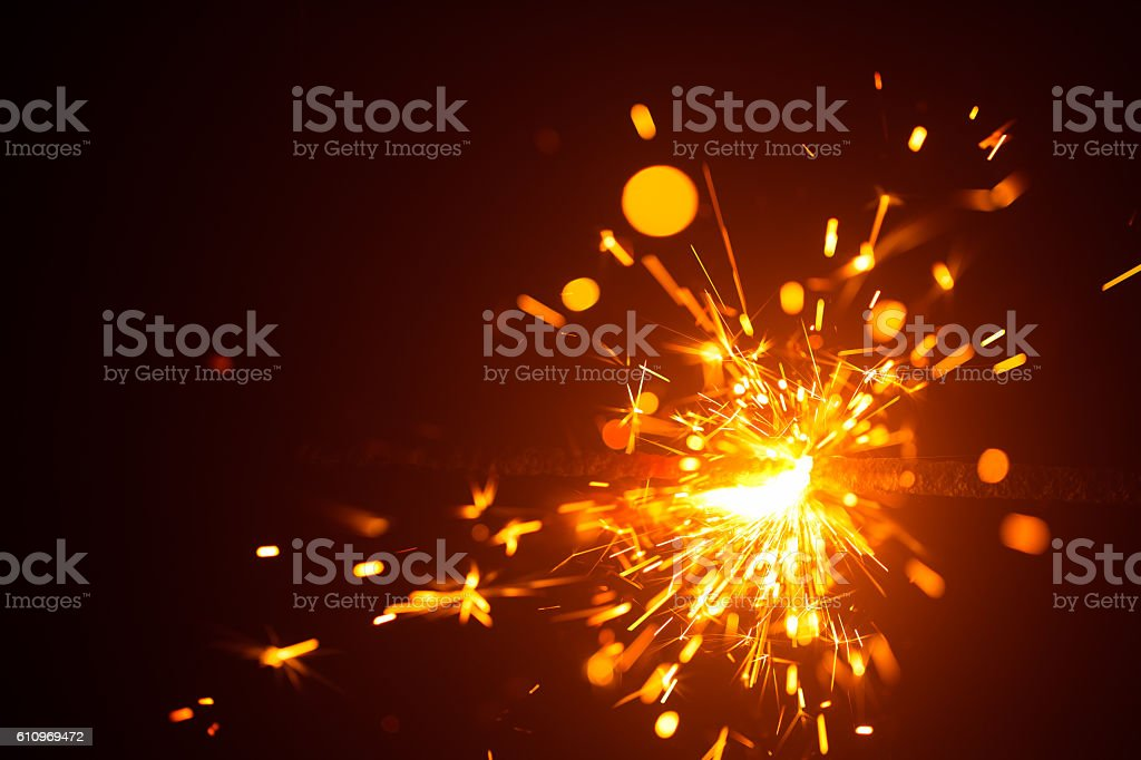 Christmas sparkler in haze with red light stock photo