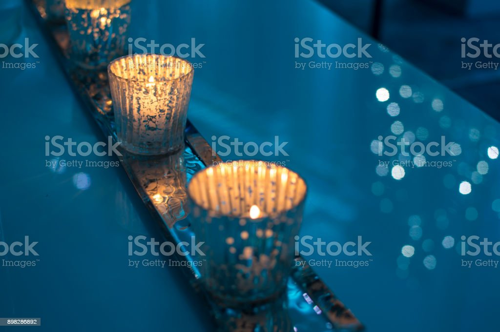 Christmas Sparkling candles and New Year's wishes  greeting background with copy space stock photo