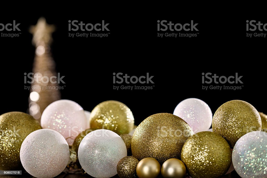 Christmas spheres over black background. Christmas is a time for...