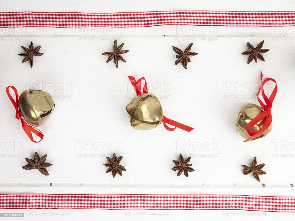 christmas spice sleigh bells and checked red ribbon stock photo