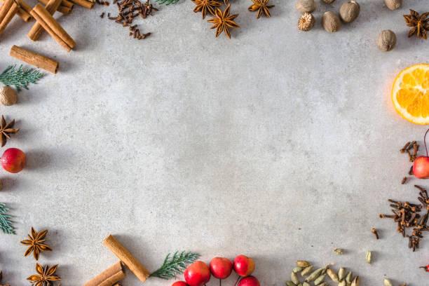 navidad especias fondo, marco de la comida de navidad, ver plano endecha, superior - clavo especia fotografías e imágenes de stock