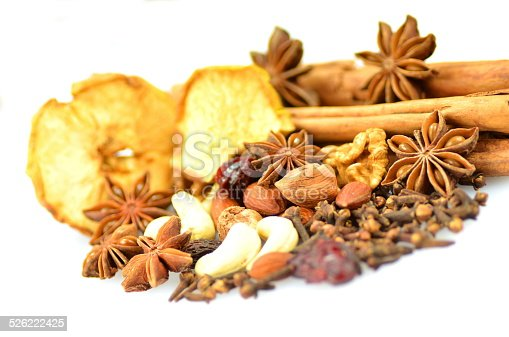 istock Christmas spices, nuts and dried fruits on white background 526222425
