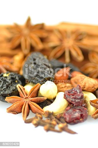 istock Christmas spices, nuts and dried fruits on white background 526222429