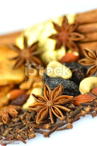 istock Christmas spices, nuts and dried fruits on white background 526223263