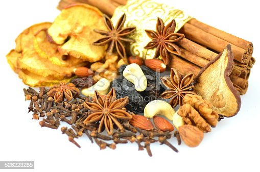 istock Christmas spices, nuts and dried fruits on white background 526223265