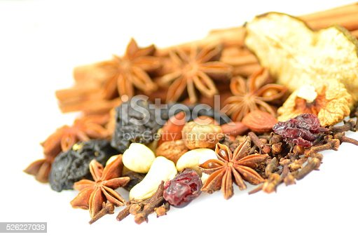 istock Christmas spices, nuts and dried fruits on white background 526227039