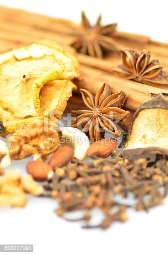istock Christmas spices, nuts and dried fruits on white background 526227091