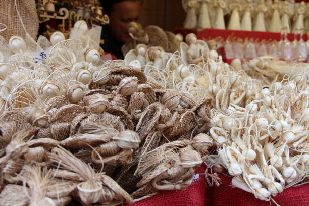 A Christmas stall in Prague sells hand-made angels stock photo