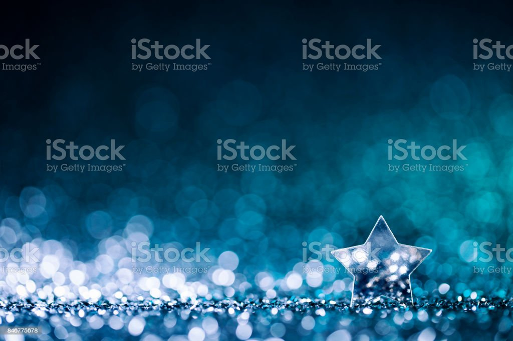 Christmas Star - Defocused Decoration Blue Bokeh stock photo