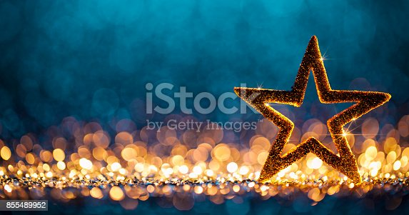 istock Christmas Star - Defocused Decoration Gold Blue Bokeh Background 855489952