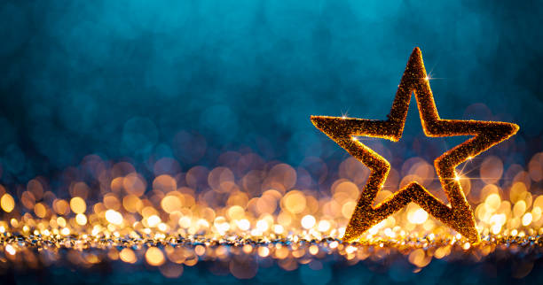 christmas star - defocused decoration gold blue bokeh background - star shape stock photos and pictures
