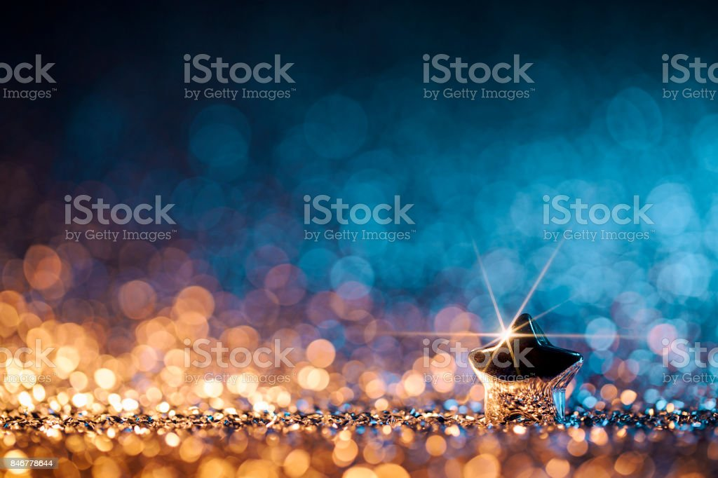Christmas Star - Defocused Decoration Gold Blue Bokeh stock photo