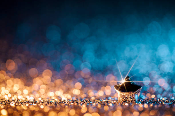 christmas star - defocused decoration gold blue bokeh - star shape stock photos and pictures