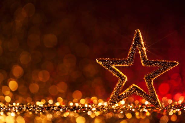 Christmas Star - Defocused Decoration Gold Red Bokeh Background stock photo