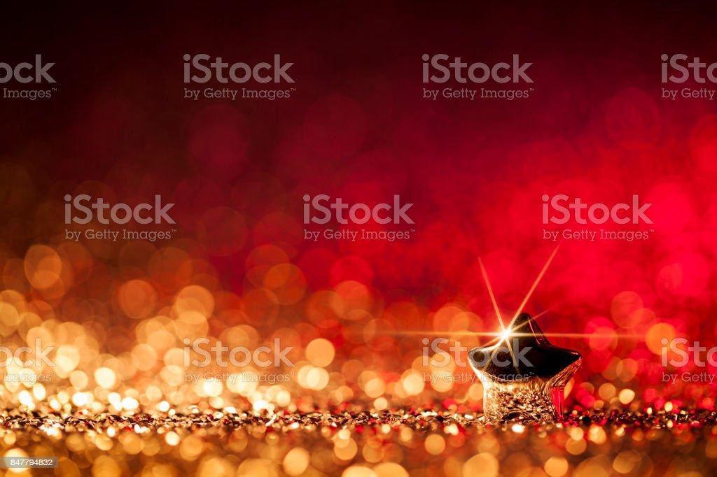 Weihnachtsstern - unscharf gestellt Dekoration Gold Rot Bokeh Hintergrund – Foto