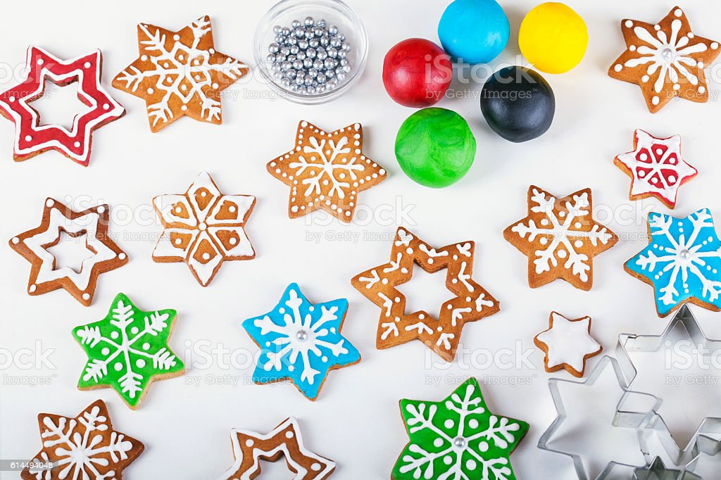 christmas star shaped cookies in different sizes and colorful fondant royalty free stock photo