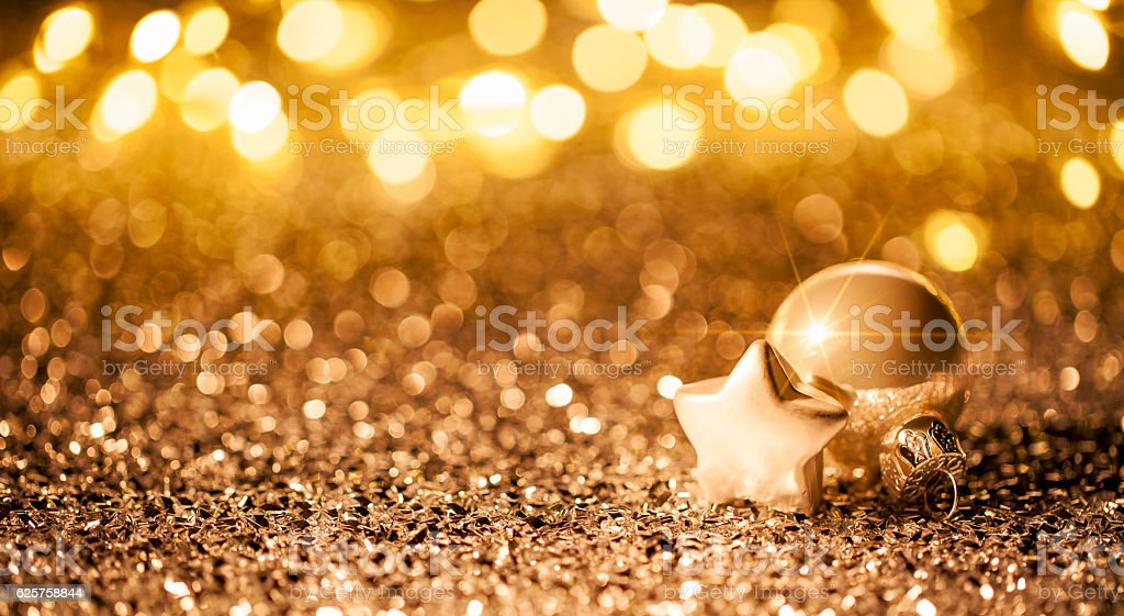 Christmas Star with ornament on Glitter - Bokeh Defocused Gold stock photo