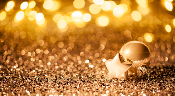 Christmas Star With Ornament On Glitter Bokeh Defocused Gold Stock Photo - Download Image Now