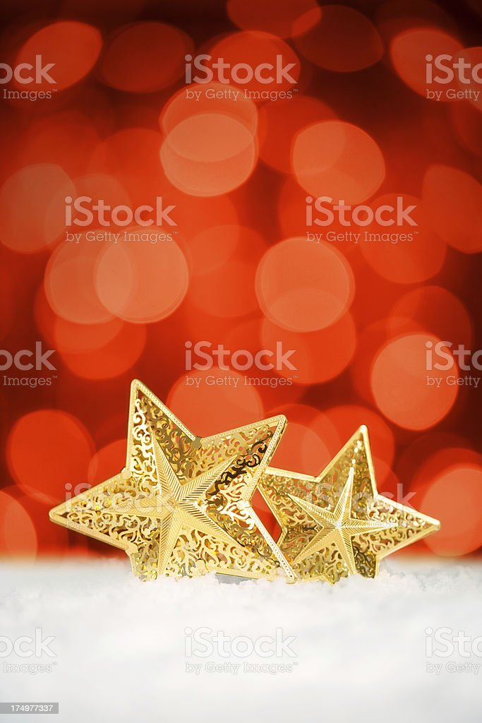 Christmas star-shaped ornaments over red background royalty-free stock photo
