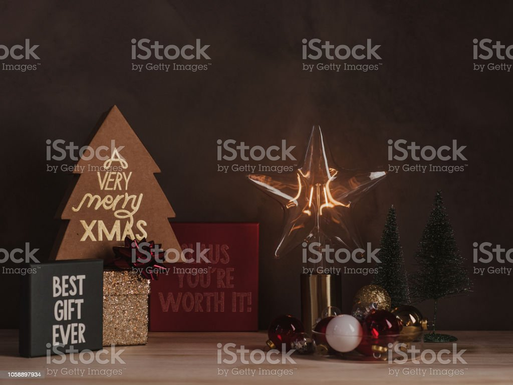 Christmas still life with gifts and advent lights Electric lamp in...