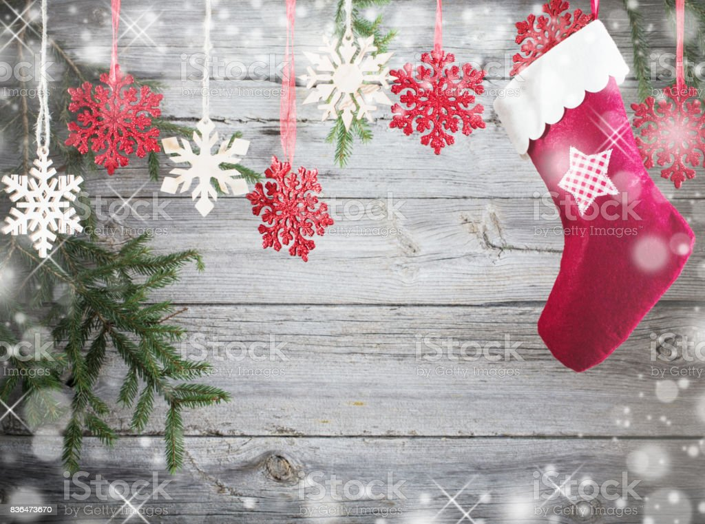 Christmas stocking hanging against wooden background stock photo