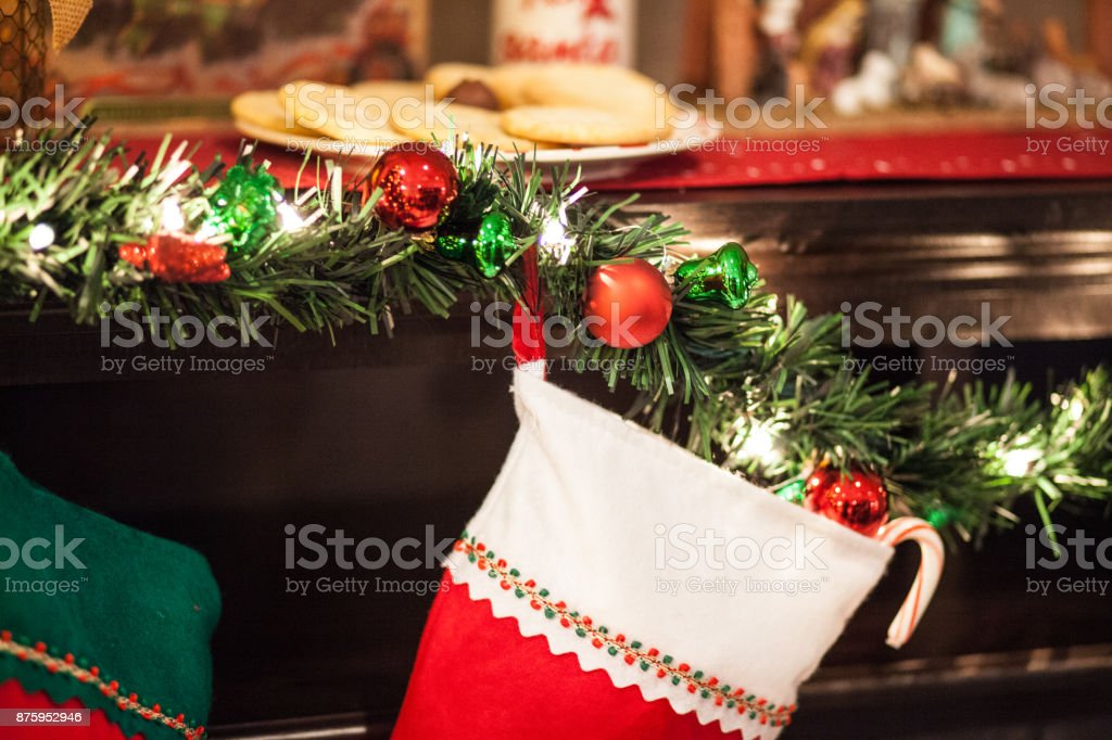 Christmas Stocking on Mantle with Cookies stock photo