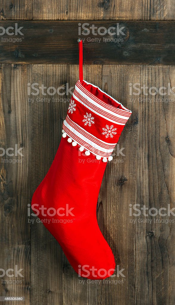 Christmas stocking. Red sock for Santa gifts. Holidays decoration stock photo