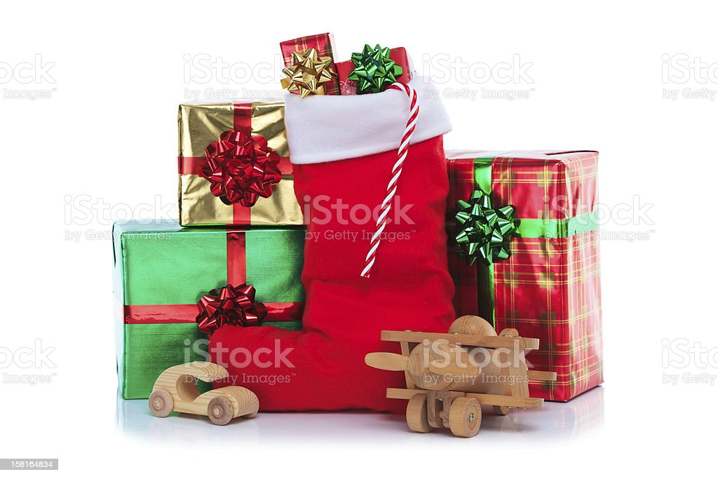 Christmas stocking with gifts wrapped presents and toys stock photo