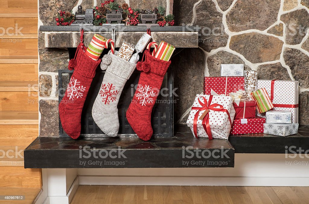 Christmas stockings and presents stock photo