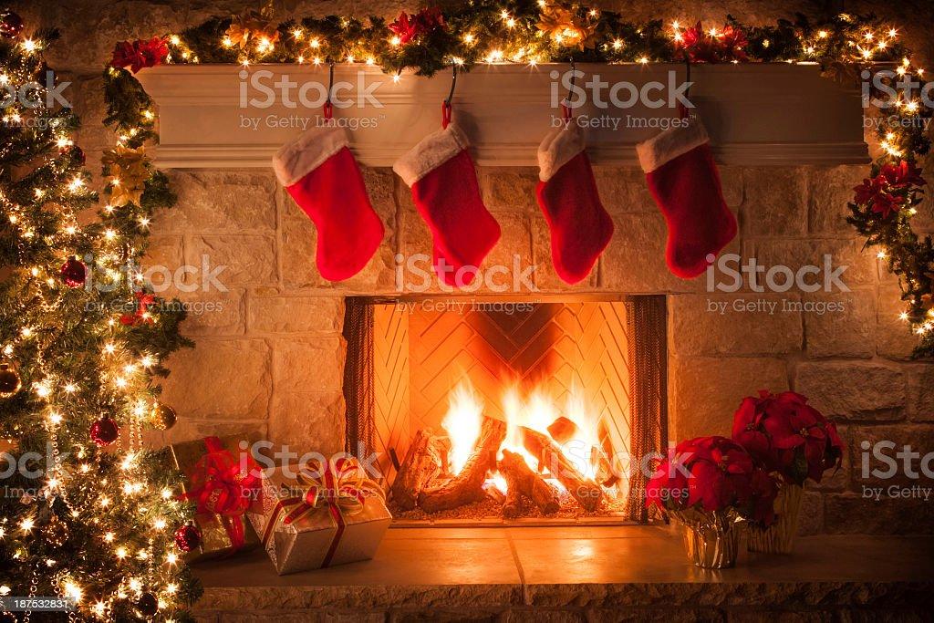 Christmas stockings, fireplace, tree, and decorations royalty-free stock  photo - Christmas Stockings Fireplace Tree And Decorations Stock Photo
