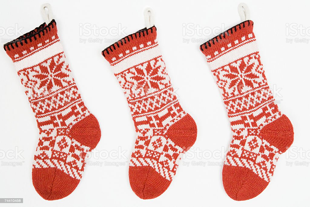 Christmas stockings in a row stock photo
