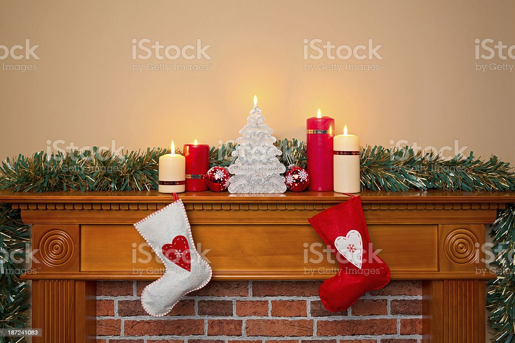 Christmas stockings over a fireplace stock photo