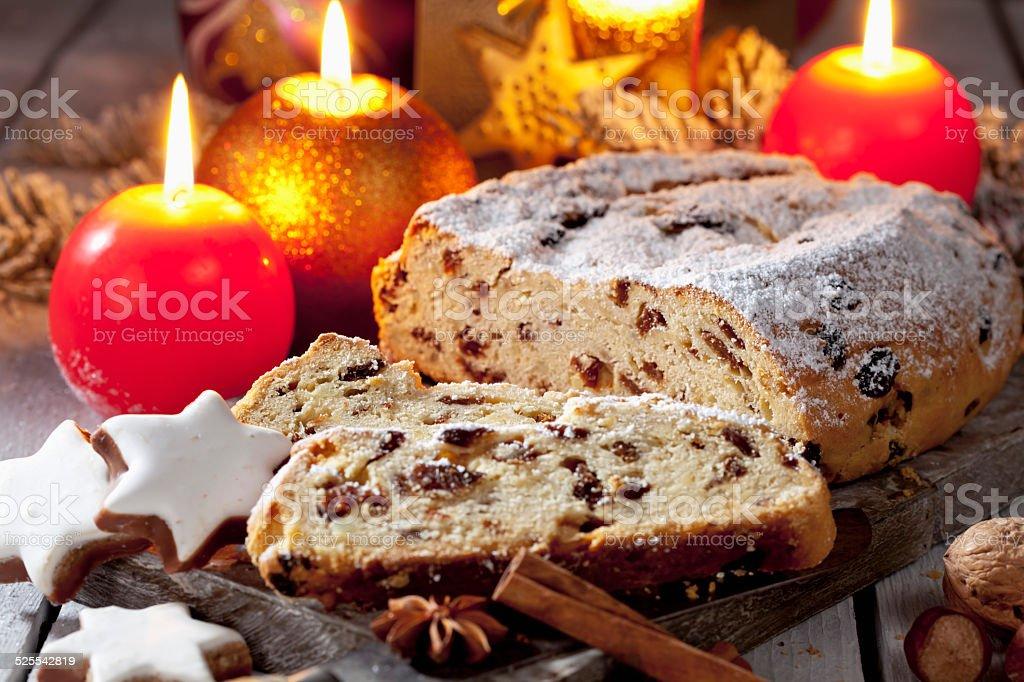 Christmas stollen, candles cinnamon stars, wooden board stock photo