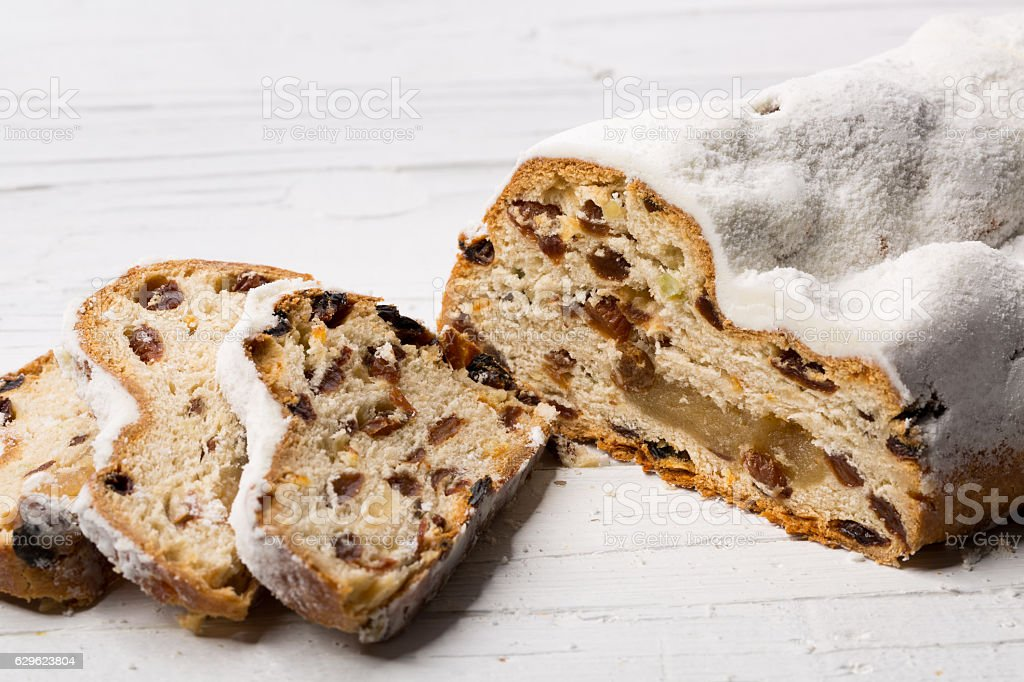 Christmas stollen on white wooden background stock photo