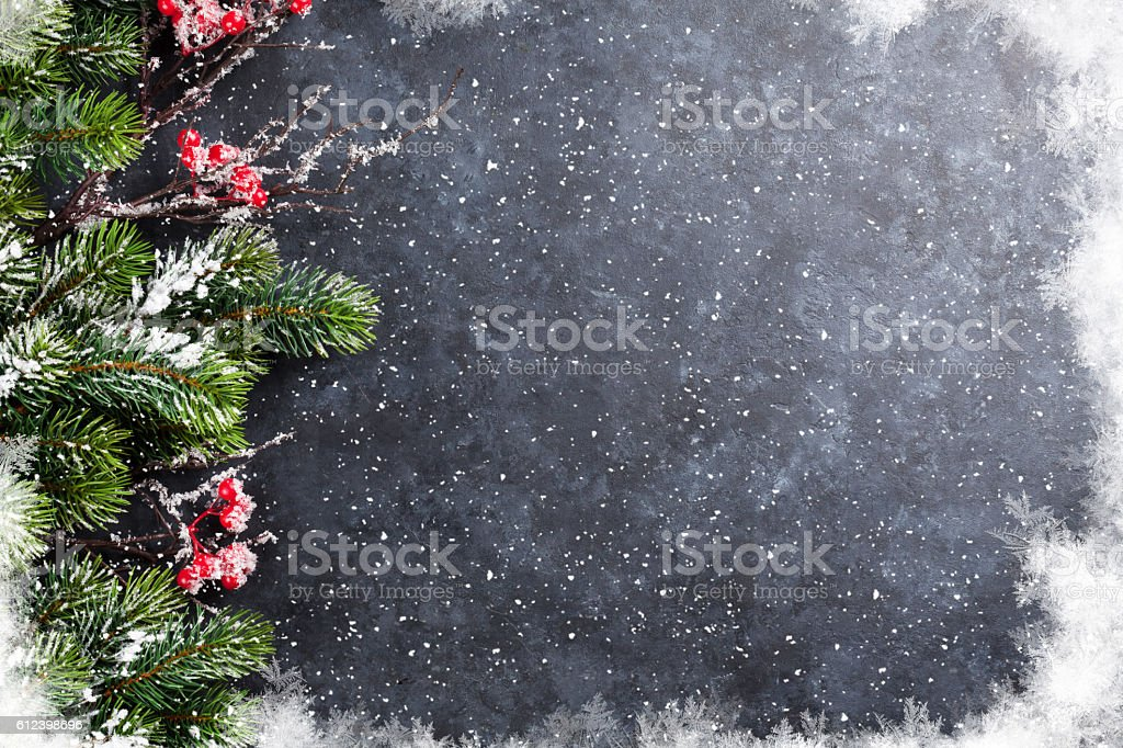 Christmas stone background with snow fir tree stock photo