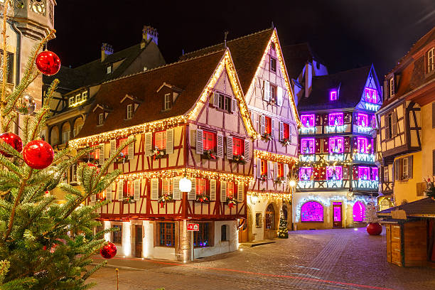 Christmas street at night in Colmar, Alsace, France stock photo