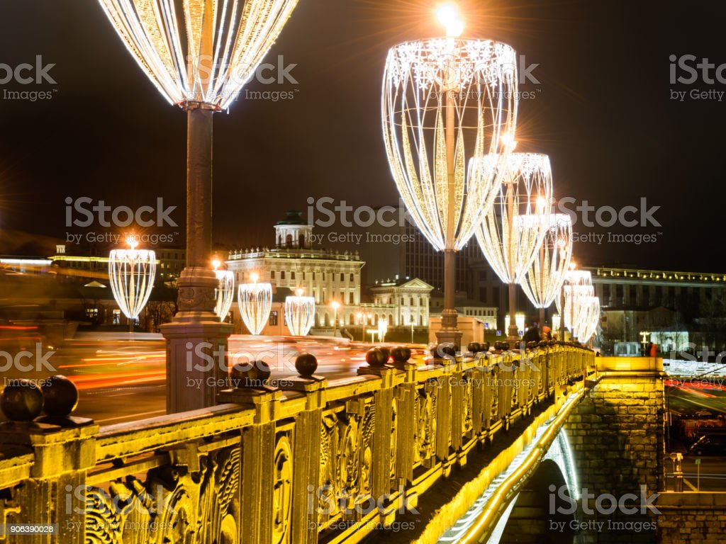 Street lights in the form of glasses of champagne wine on bridge near...