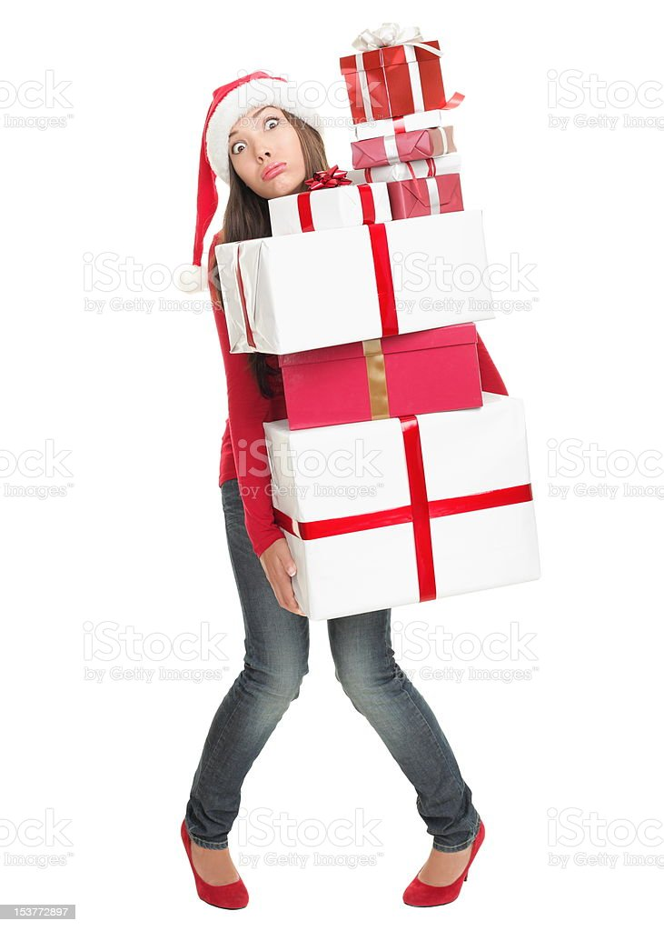 Christmas stress woman tired with many gifts stock photo