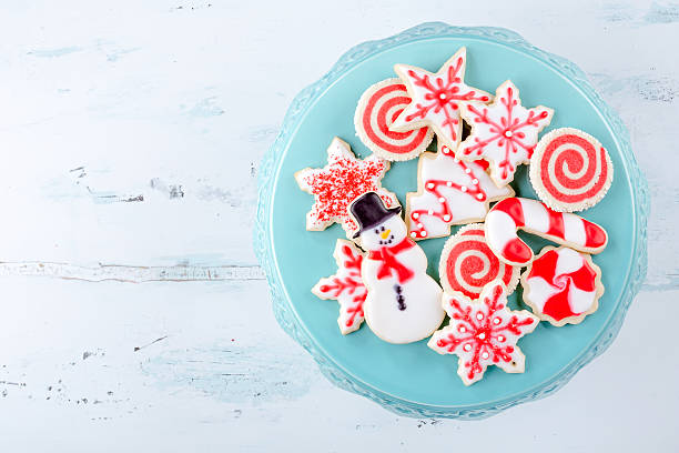 Christmas Sugar Cookies Red and White Christmas Sugar Cookies on a plate sugar cookie stock pictures, royalty-free photos & images