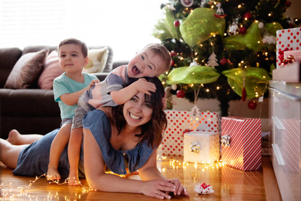 christmas summer with single mother and her sons - manonallard stock photos and pictures