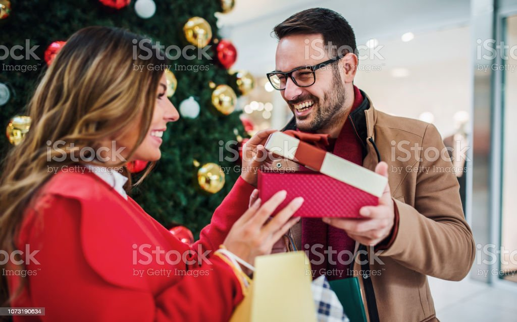 New Year\'s surprise for a girlfriend. Beautiful young couple looking...