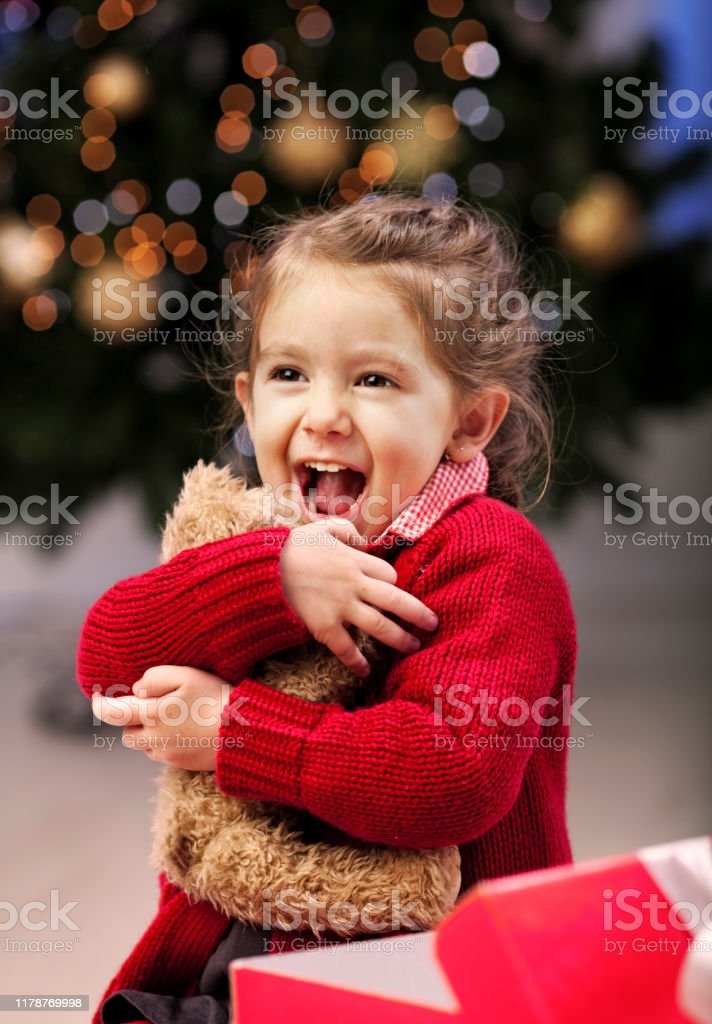 Little girl excited of the present she have got , it was the same...