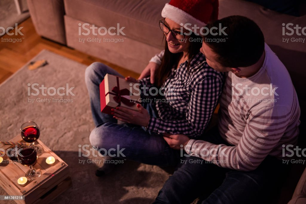 Young Married People Sharing gifts On Christmas Eve