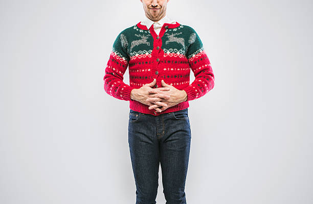 christmas sweater man - ugly sweater stock photos and pictures