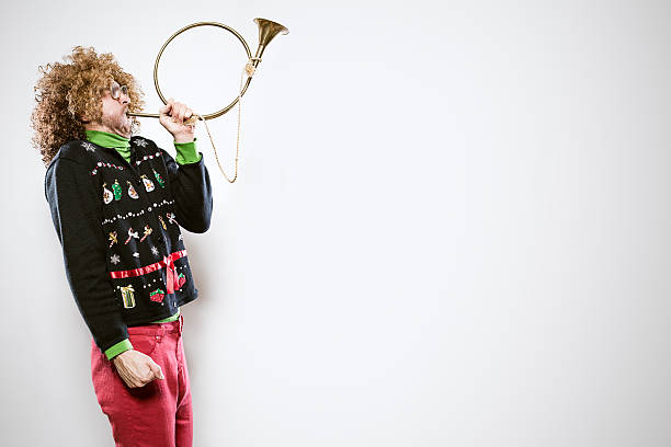 christmas sweater man with trumpet - ugly sweater stock photos and pictures