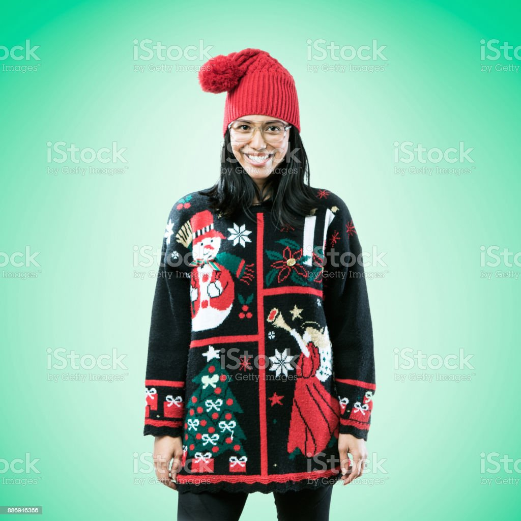 Christmas Sweater Woman on Green Background stock photo