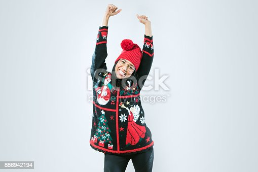 istock Christmas Sweater Woman 886942194