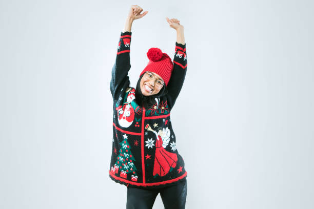 christmas sweater woman - ugly sweater stock pictures, royalty-free photos & images