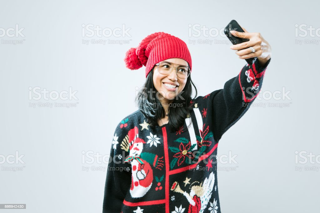 Christmas Sweater Woman Taking Selfie stock photo