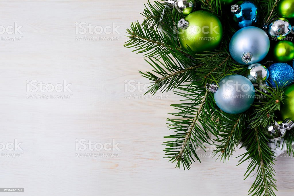 Christmas table centerpiece with fir branches, blue and green or stock photo